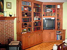 The design of this maple bookcase, as well as its stained and lacquered finish, match existing kitchen cabinetry in the same room.