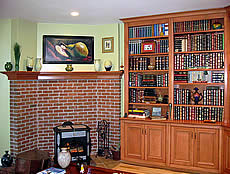 This photo shows the maple bookcase with a matching mantle shelf installed next to it.