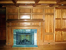 Part of a larger, whole-room project, this integrated paneled fireplace surround is crafted of cherry