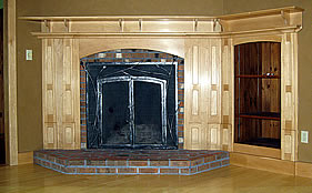 This maple surround and mantle integrates the fireplace and adjacent built-in bookshelves.